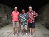 At a WWII Japanese tunnel near Rabaul.  LtoR: the author, Sir Rabbie Namaliu, Bill Gammage. (Or possibly an elderly rugby front row.)